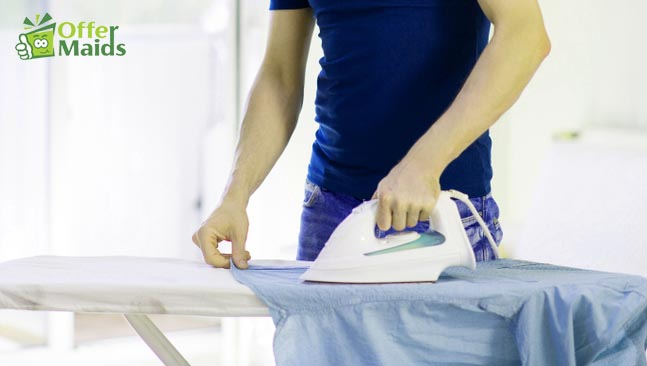 shirt ironing on the top of table using iron box